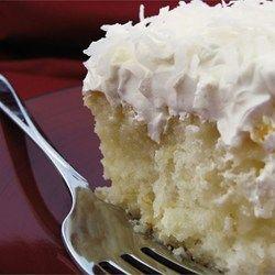 Coconut Poke Cake Recipe and Video -- like the idea of cream of coconut & condensed milk poured over cake