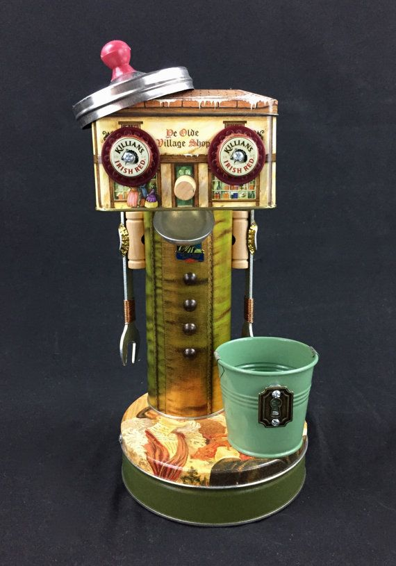 This is lewis lockhart and he is a found object robot tip jar this is lewis lockhart and he is a found object robot tip jarbusiness card holder he stands 14 inches tall and is made from object collected from thrift reheart Images