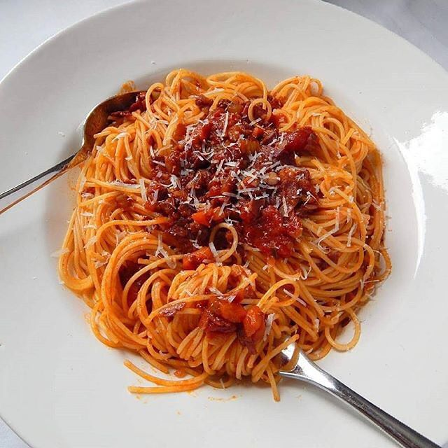 Pasta perfection with spicy red wine sauce and bacon via @pepiskitchen #howiholiday by foodandwine