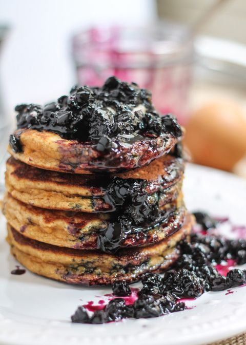 AMAZING grain-free, paleo-friendly coconut flour pancakes served with fresh wild blueberry maple syrup. These are so fluffy! #paleo #glutenfree