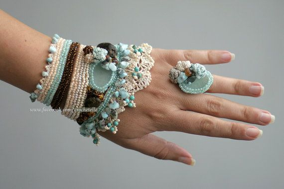 Unique handmade crochet cuff with crochet ring in creme, light blue and brown colors with lot of Baltic amber, larimar, turquoise and glass beads.