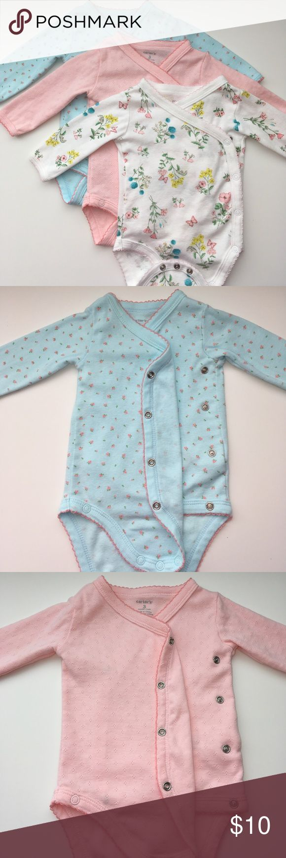 🎀Carter's Side Snap Onesie Set🎀 Used - good condition. Carter's baby girl side snap onesie set size 3 months. Includes one light blue, peach, and white with flowers. Clean and no stains or rips. Carter's One Pieces Bodysuits