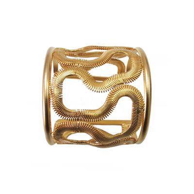 Pulsera ajustable tipo esclava Bañada en Oro.  www.blucompany.cl