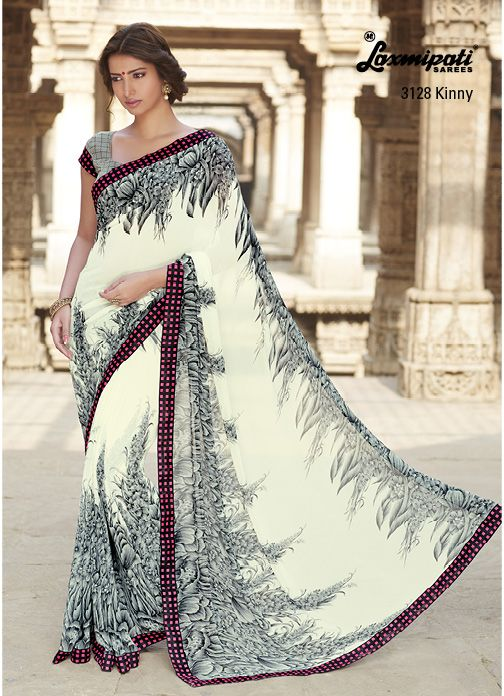 Gray, gray & offwhite floral print on the offwhite georgette saree is catching attention with black & magenta raw silk printed lace.