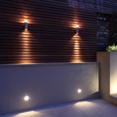 exterior lighting provides a warm patterned uplight and a shaft of downlight…