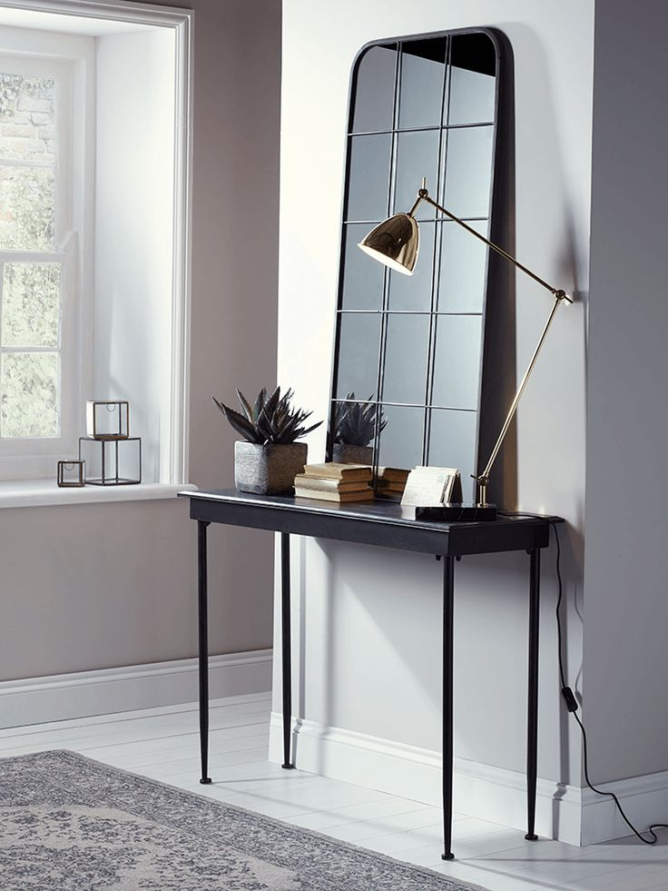 Made from metal with a distressed, vintage-effect finish, our mottled black console table is perfect for displaying ornaments and keepsakes in your hallway or living space. To complement the look, also see our matching Antiqued Metal Side Table