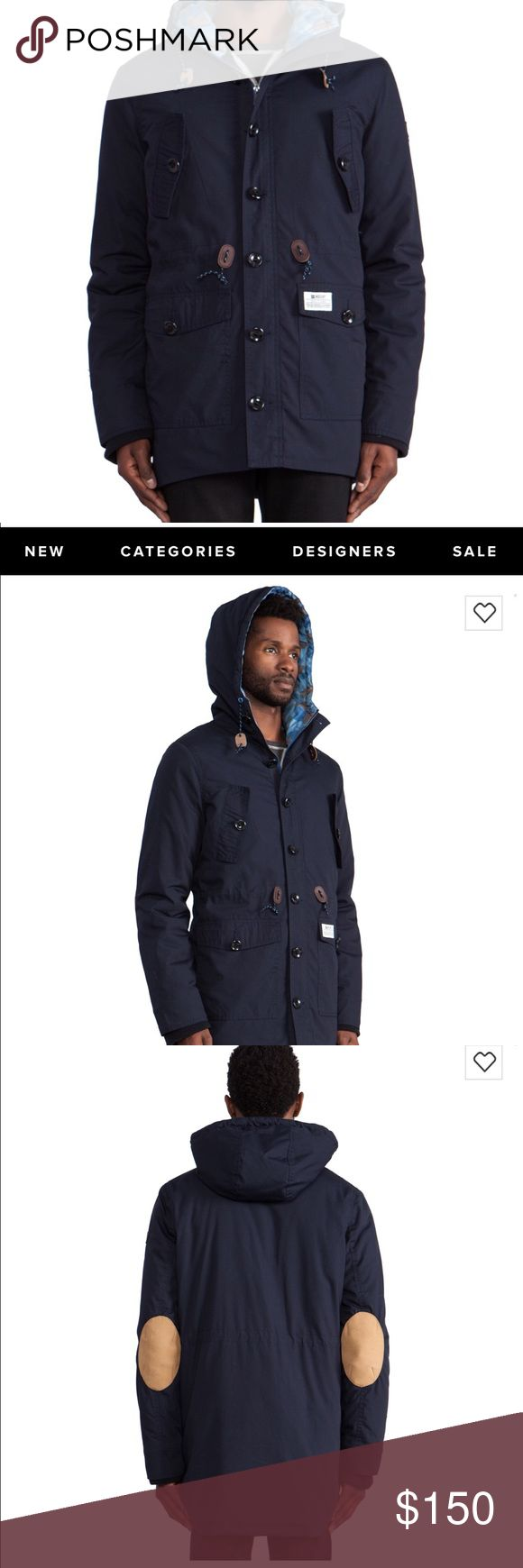 """Insight """"The Rainmaker"""" Navy down Parka Insight """"The Rainmaker"""" Goose filled parka. Navy outer — Camo lined inner. Leather elbow patches and leather details. This parka features a drawstring hood for added protection, as well as elbow patches and zipper with button closure for extra aesthetic. This jacket is an essential piece for the winter season.  Drawstring hood Zipper with button closure Horizontal chest pockets Hand pockets with button closure Leather Elbow patches Patterned lining…"""