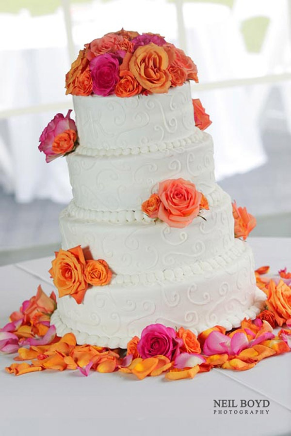 White Wedding Cake With Pink Orange Roses Raleigh Nc Weddings