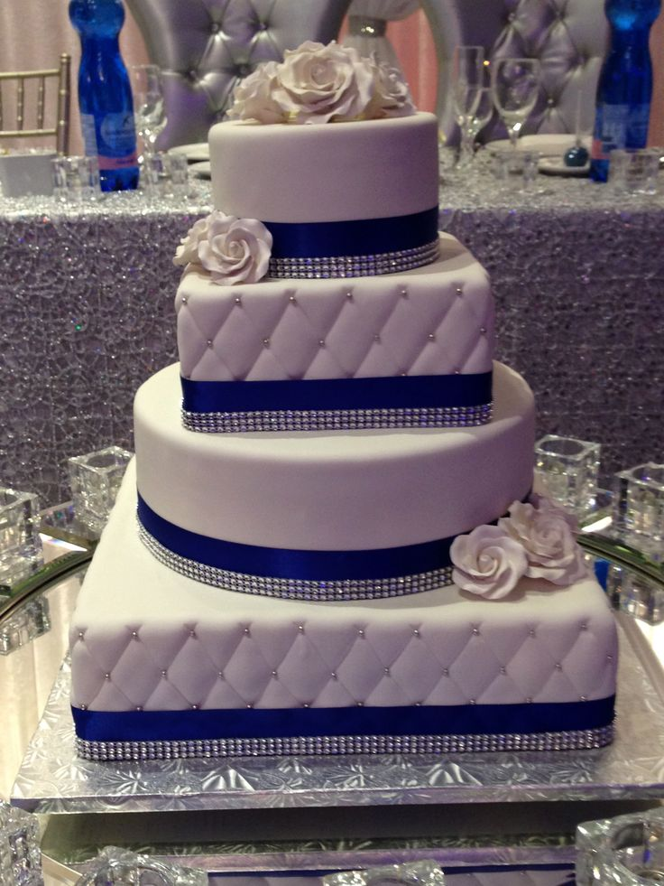 "Royal blue trimmed 4 tier round and square wedding cake. This cake is sized 6"" round,8"" square,12"" round,14"" square."