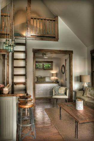 #tumbleweed #tinyhouses #tinyhome #tinyhouseplans Mason jar lights. This is beautiful. From the look of the kitchen island and the bar stools, the kitchen is likely to be nicely done as well. I like the loft for a master bedroom. The bedroom displayed can be turned into a bunk room. I would also consider sliding barn doors as a separation for the bedroom.