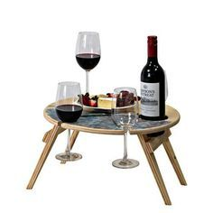 A portable picnic table is a must-have summer essential! Keep the sand off your picnic with a stylish, fold up, wooden outdoor table from Recycled Mats.