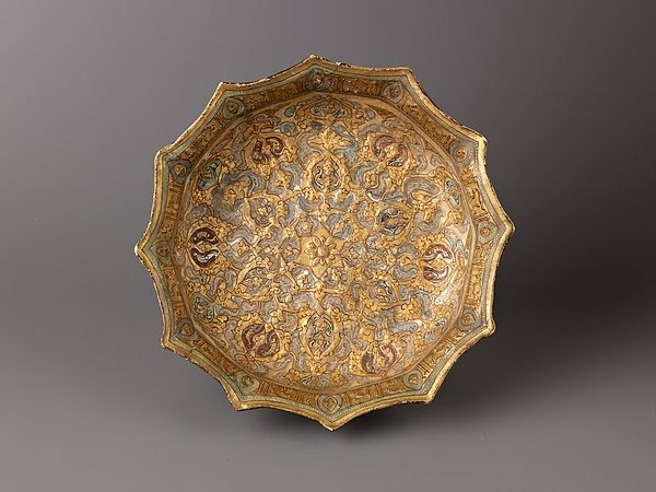 """Faceted Basin, Mina'i (""""enameled"""") ware Date:early 13th century Culture:Iranian Medium:Mina'i ware. Fritware, stain-and overglaze-painted, and gilded. Dimensions:Diameter: 9 in. (23 cm)"""
