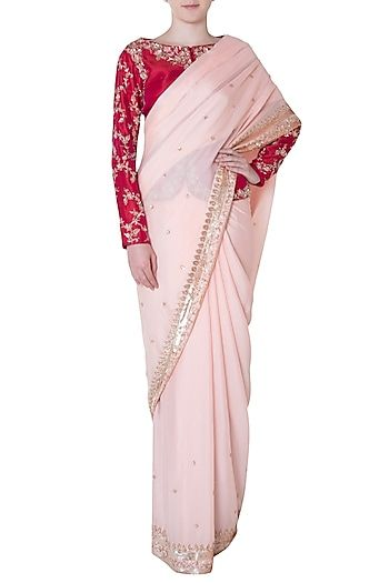 92a94dcd2725c PINK PEACOCK COUTURE Featuring a peach saree in raw silk base with 3D rose  gold handwork embroidery. It is paired with a matching dark pink jacket  blouse in ...