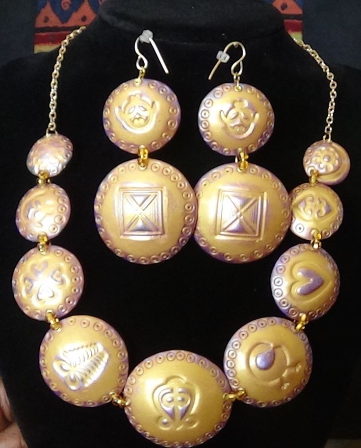 Adinkra Symbol Necklace Set in Royal Gold and Purple by Earth and Ocean Jewelry Designs. Created with polymer clay, this lightweight beauty is a sure eye catcher for the fashion Diva to add to her wardrobe.