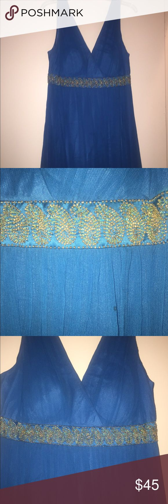 Blue Aztec Cocktail Dress Worn once. Maggy London blue with gold and blue beading at empire waist. Has one tiny stain size of a marker tip on the dress which is pictured near beading. Make an offer! Maggy London Dresses