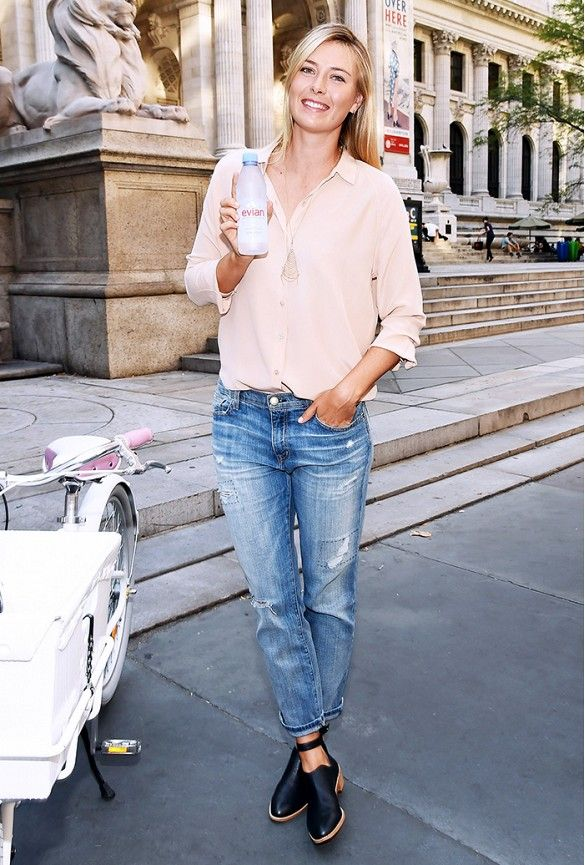 Maria Sharapova wears a silk button-down shirt and boyfriend jeans.