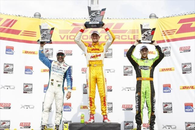 Tony Kanaan (3), Ryan Hunter-Reay (1), James Hinchcliffe (2) on the podium of Victory circle at the Milwaukee IndyFest.