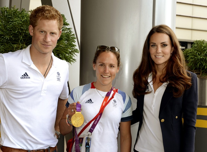 Prince Harry and Catherine, Duchess of Cambridge pose with Gold medal winning rower Sophie Hosking at Team GB House in the Westfield Centre on Day 13 of the London 2012 Olympic Games on August 9, 2012 in London, England.