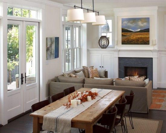 the french doors and the table itself all bring this space to life without losing the fireplace traditional dining room by artistic designs for living