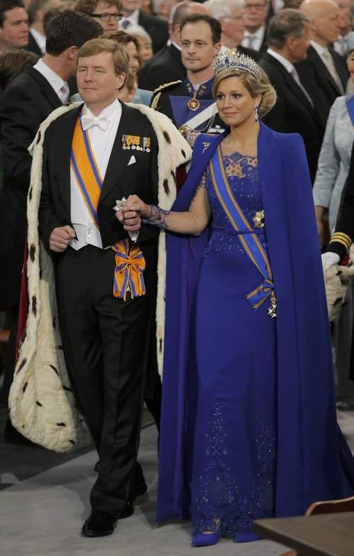 King Wilhelm and his Queen Consort Maxima. Maxima looks absolutely dazzling in blue, with sapphire tiara.
