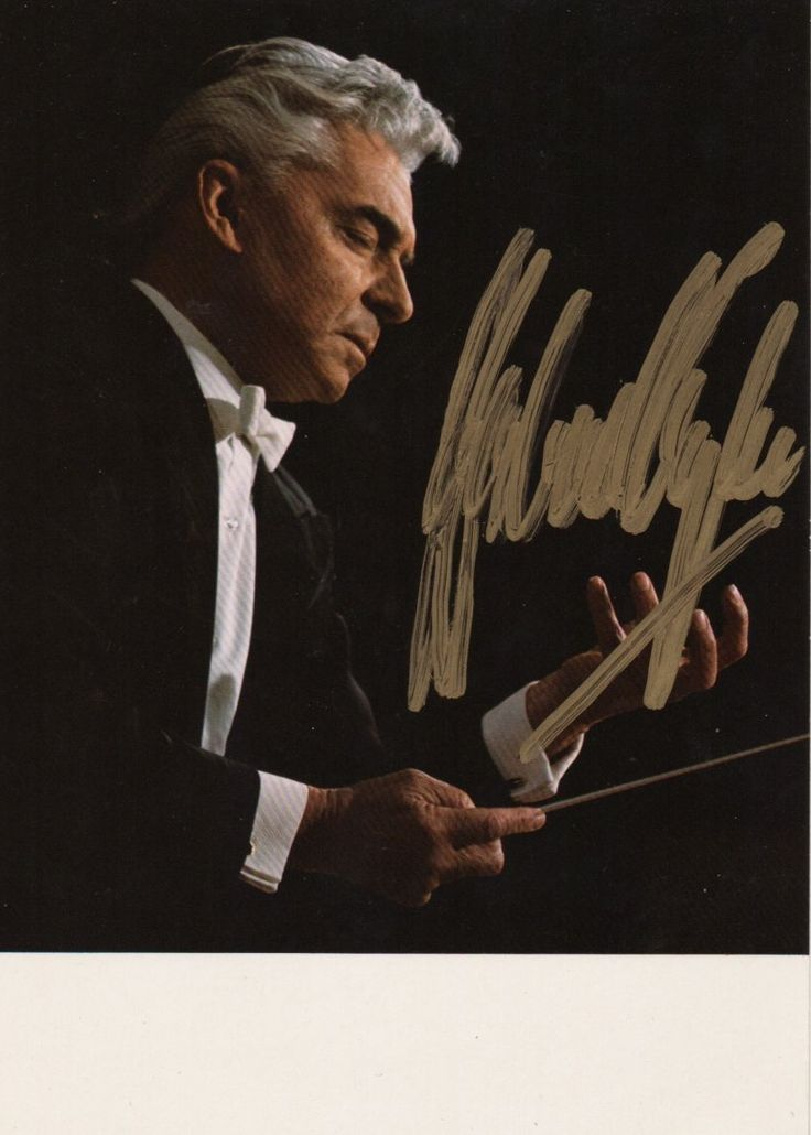 KARAJAN HERBERT VON: (1908-1989) Austrian Conductor. Signed colour 4 x 6 postcard photograph, the image depicting Karajan in a half-length pose, conducting with baton in hand. Signed by Karajan in bold gold ink with his name alone to a clear area of the image.