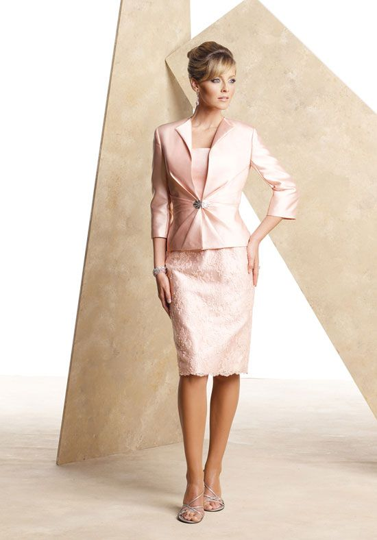 Mother of the bride suit dress with a long sleeve jacket.  Pastel pink colored mother of the bride formal wear.  2 pc evening wear for the mothers of the wedding.