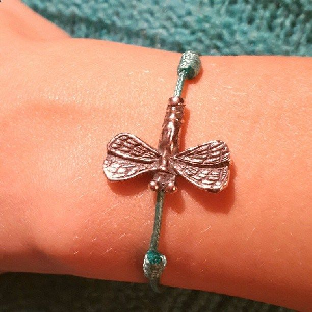 Cord sterling silver bracelet with dragonfly charm.Dragonfly symbolizes ease, grace, speed. Furthermore this ancient insect like a dragonfly, survived from the Jurassic period. Usually insects symbolize the short life on Earth, but the dragonfly as a butterfly is a symbol of salvation, of rebirth, immortality.Thread Bracelet Dragonfly - a great gift for those who seem not to have enough ease in life.Amorem. Sterling silver. Handmade. Features adjustable cord.