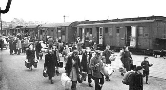 A train with refugees (Displaced Persons) arrives at a temporay DP Camp somewhere in Germany.