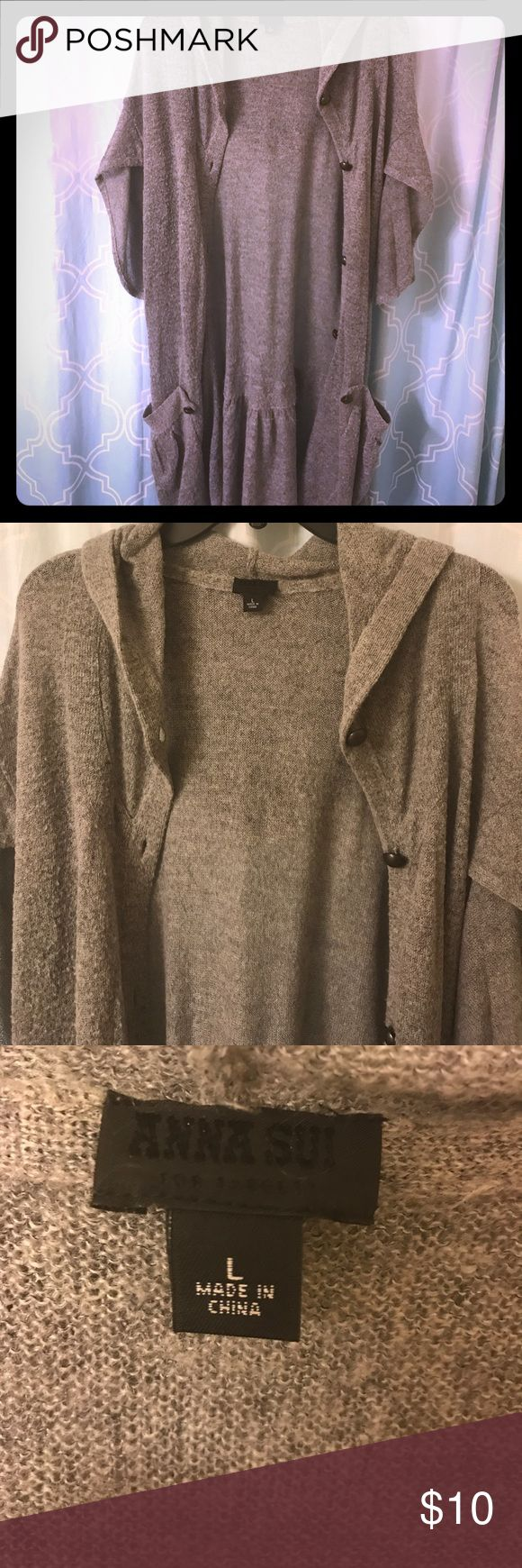 Grey slouchy sweater by Anna Sui Grey floor length sweater by Anna Sui! I've had this sweater so long! It's got that worn edgy look to it, which I love. It goes great with skinny jeans and a pair of black boots! Anna Sui Sweaters Shrugs & Ponchos