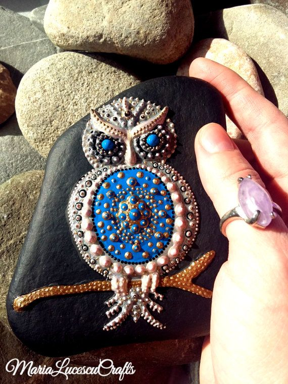 Owl painted on a stone in acrylic paint by MariaLucescuCrafts