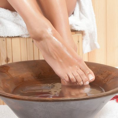 At the first sign of a cold or flu, I soak my feet up to my ankles in hot water—as hot as I can stand without scalding—for 20 minutes before going to bed. I also take 5,000 milligrams of vitamin C a day for five days.—Erika Schwartz, M.D