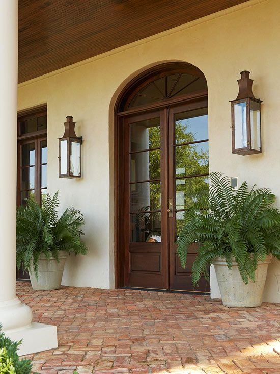We love the look of these dark wood French doors! Find ways to add color to your home: http://www.bhg.com/home-improvement/exteriors/curb-appeal/add-exterior-color/?socsrc=bhgpin032113frenchdoors=4