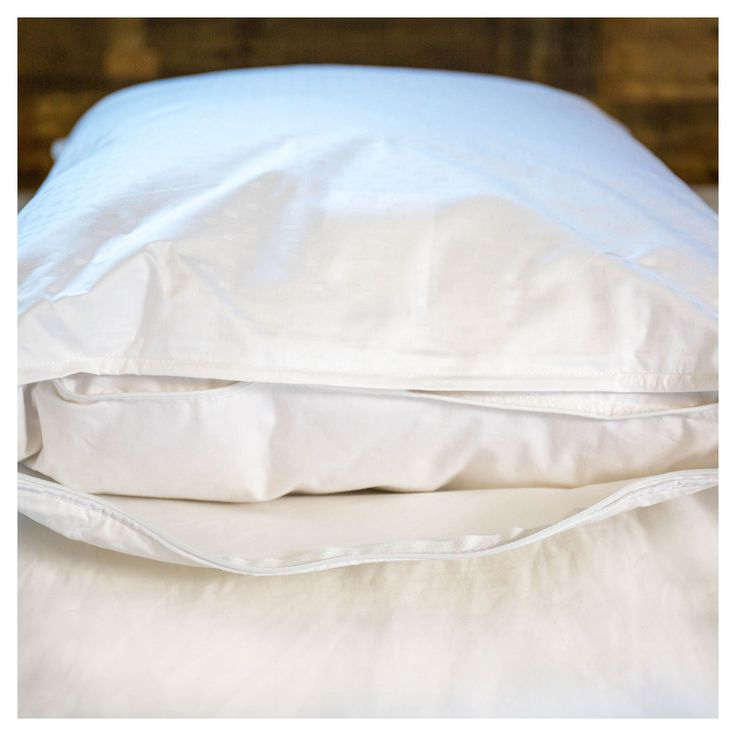 Luxury White Goose Down Pillow - 600 Fill Power A restful night's sleep guaranteed with the Hypo-Allergenic Luxury RDS certified White Goose Down Pillow. It is covered in a soft 330 Thread Count 100% Cotton Dobby Dot Weave outer removable cover that protects your pillow and keeps it clean. The down stays securely inside an inner 233 Thread Count cover. The adjustable support of this Luxury Down Pillow actively conforms to your body as you change positions throughout the night.