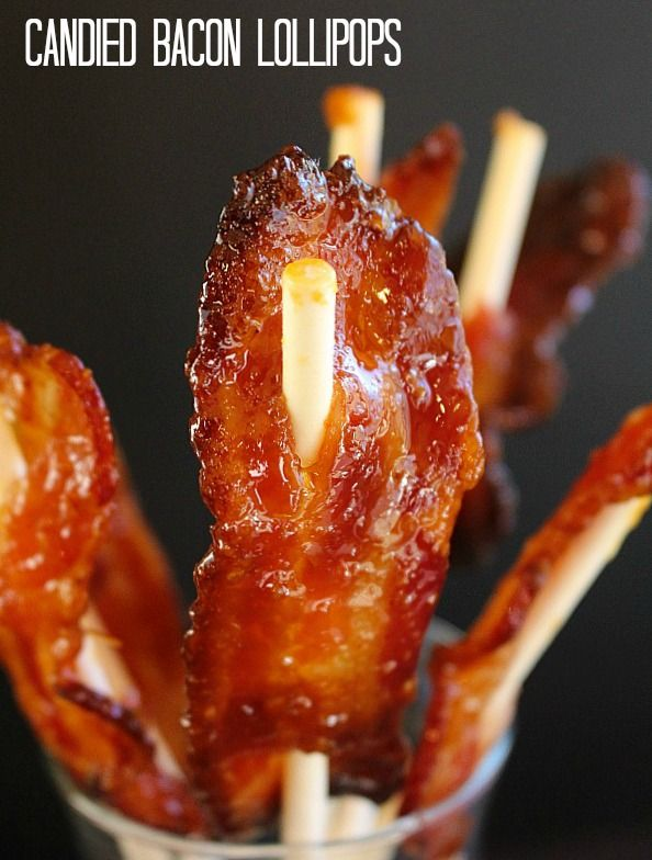 Sweet and tangy bacon, caramelized with a tangy brown sugar-dijon mustard glaze, spiked with bourbon, on lollipop sticks for easy snacking.