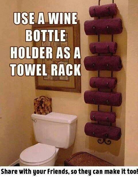Use a wine rack as a towel rack! So doing this.