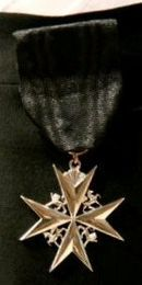 Maltese cross - The insignia of a Serving Brother of the Most Venerable Order of the Hospital of Saint John of Jerusalem