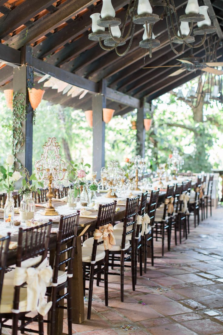 Wedding Tablescape / Gold Chandelier Candelabras by Opulent Treasures / Rustic Spring Wedding in Puerto Rico / venue: Hacienda Siesta Alegra / photo: Amanda K Photography