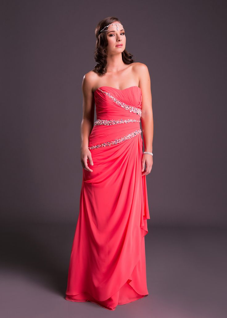 Hot in Coral Pink! This strapless dress with rouged bodice and diamante detail will fall flatteringly against any frame (style VCM52107). Click to View the Price or Book a Fitting.