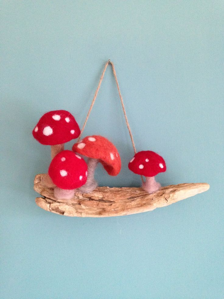 A personal favourite from my Etsy shop https://www.etsy.com/uk/listing/387402114/toadstools-on-driftwood-needle-felted