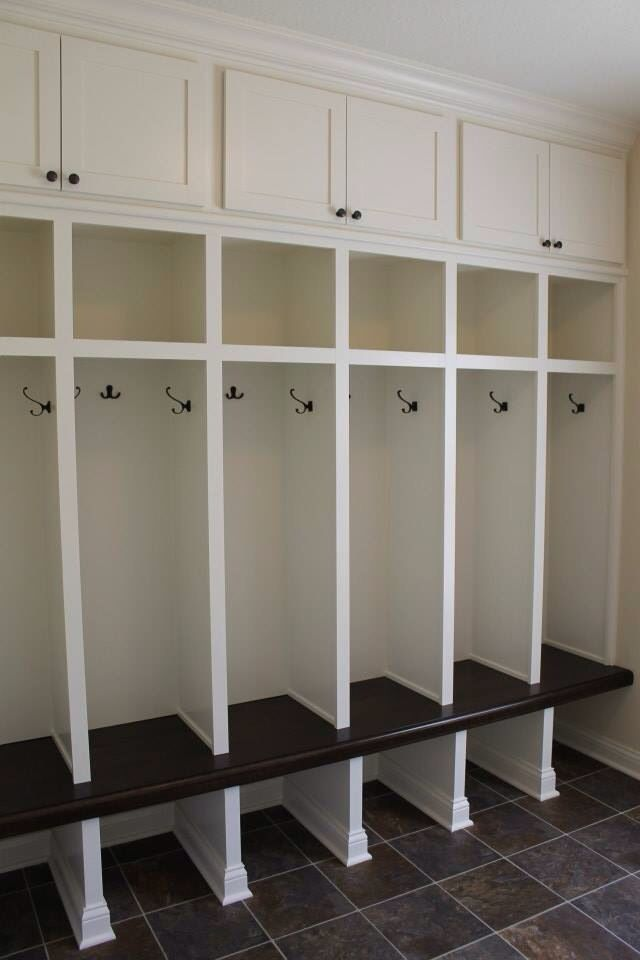 Custom built mudroom lockers with upper cabinets, solid maple bench, matching base molding and crown molding. PROJECT GALLERY - Carpentry Plus