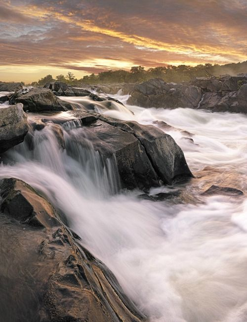 Just before it flows past Washington, DC, the Potomac River builds up speed and force as it falls over a series of steep, jagged rocks and rushes through a narrow gorge. Great Falls Park offers tremendous views of this powerful, natural spectacle. Hikers enjoy several trails along the river and sometimes gasp at expert kayakers who brave the falls. This sunrise picture was taken on the Virginia side of the river.