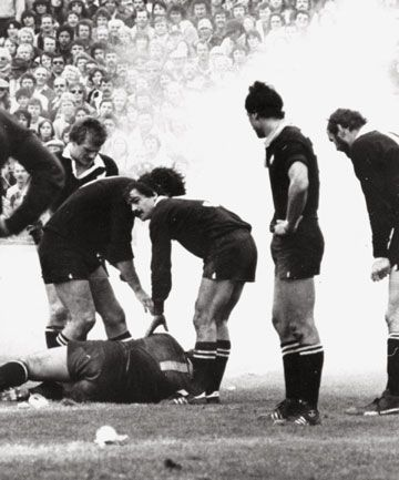 The All Blacks tend to one of their own players who had been hit by a flour bomb at Eden Park.