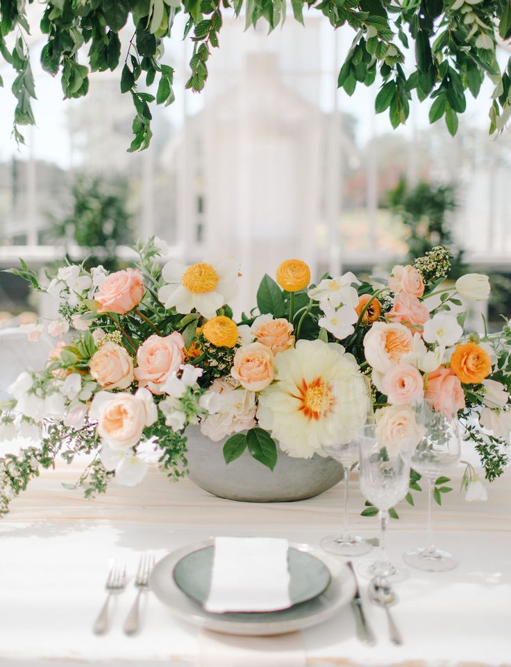 garden rose centerpiece with peach and orange tones