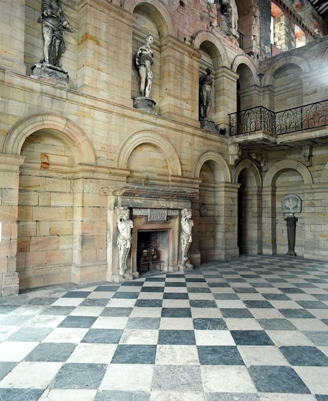 Castle Howard had a great fire which destroyed much of the interior.  This is a space that was never restored with the damage visible on the upper right of the structure & on the blackened statues.