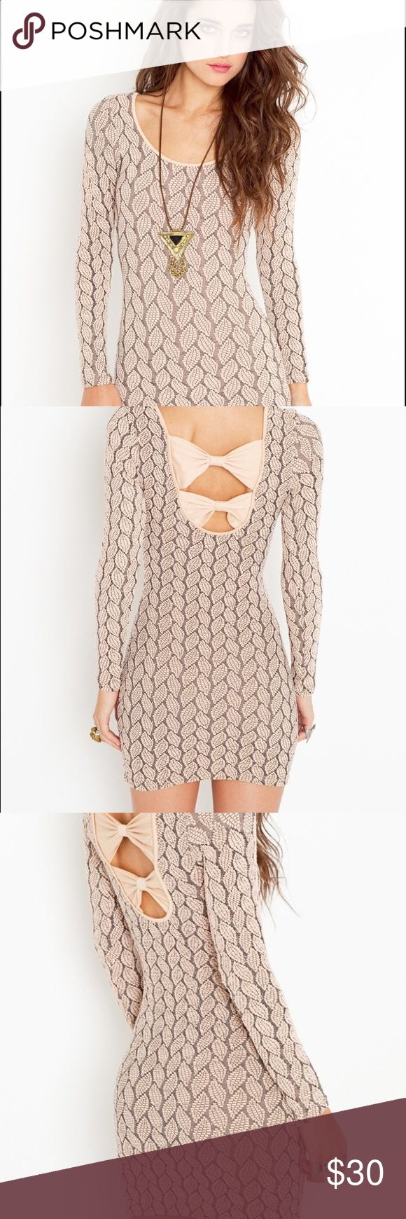 Nasty Gal Bodycon Bow Dress Form fitting gorgeous nude dress from nasty gal.  Perfect for New Year's Eve or going out with friends. In perfect condition. Worn twice Nasty Gal Dresses Mini