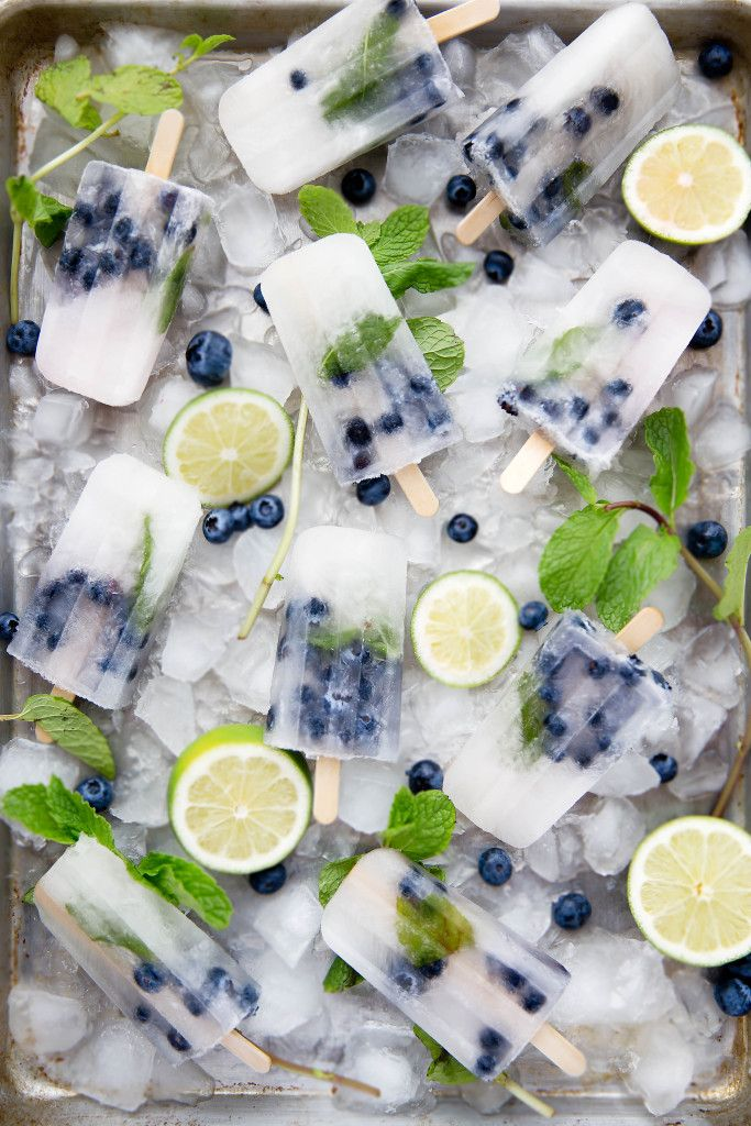 Get your booze on with these thirst-quenching Blueberry Mojito Popsicles!