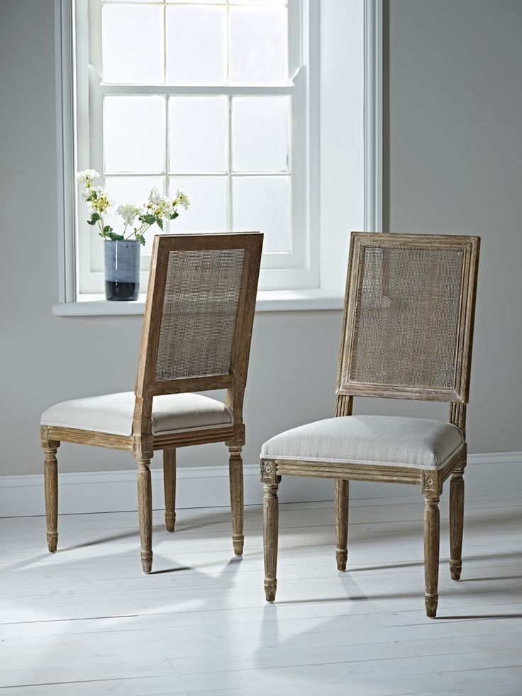 beautifully crafted from burnt oak these elegant chairs have a mesh look back and pretty details carved into the frame the seats are upholstered with pure