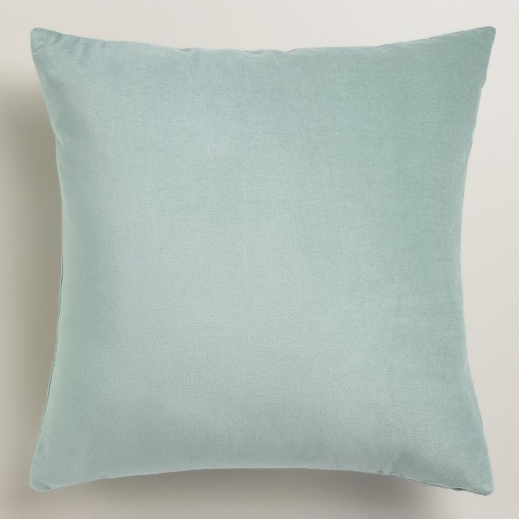 Crafted of luxurious cotton velvet, our ocean blue throw pillow is a classic accent for any room ...