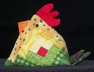 Rooster pincushion from a small log cabin block - like the tail