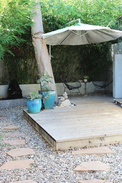 Build mini patio under tree in back to add element of comfort to small back yard.